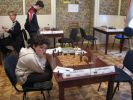 Nyzhnyk Illya sitting on crossed legs to reach the board